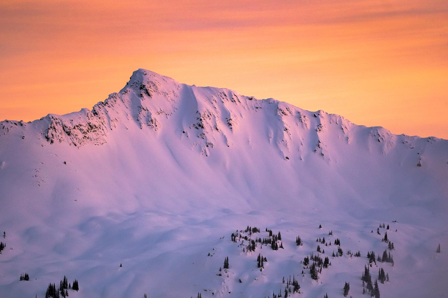 Snowy purple mountain at sunset in British Columbia, Canada