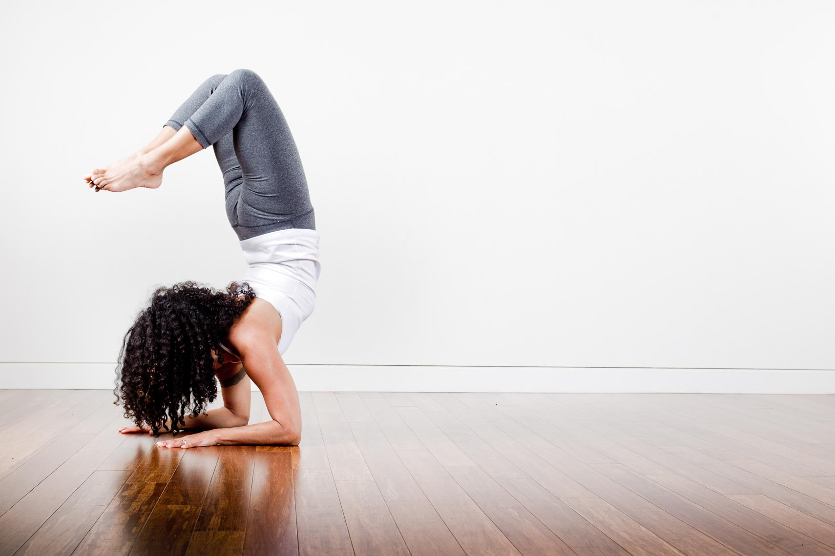 Mayurasana yoga pose shot for YYoga by commercial photographer in Vancouver