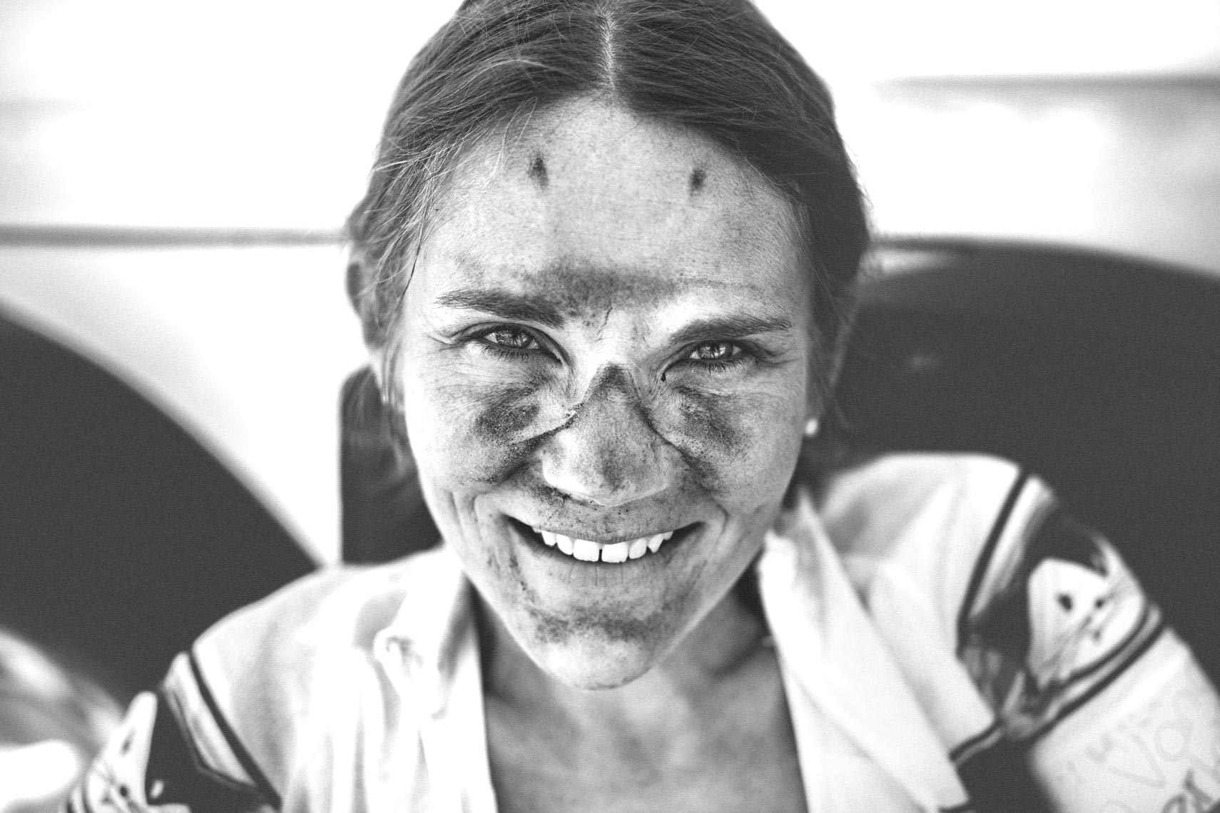 Dirty faced female mountain bike racer portrait