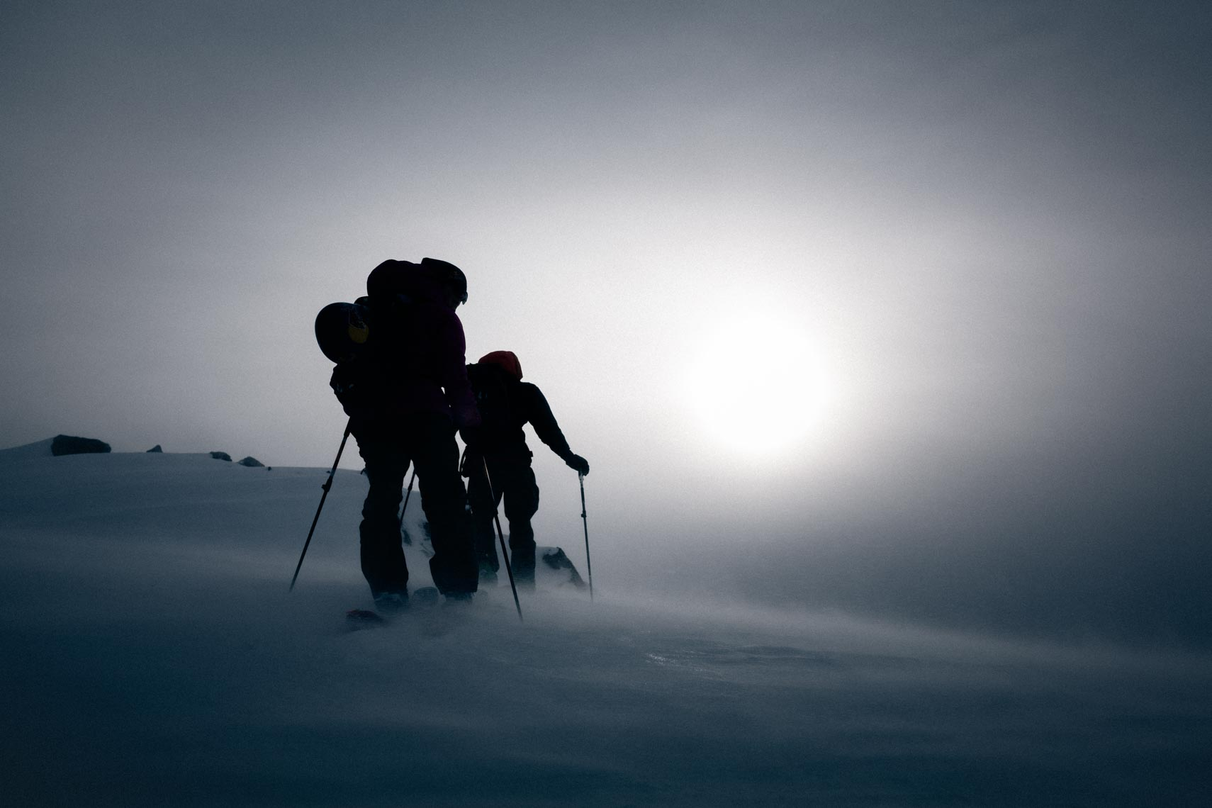 Silhouetted ski touring pro skiers photographed in Whistler BC