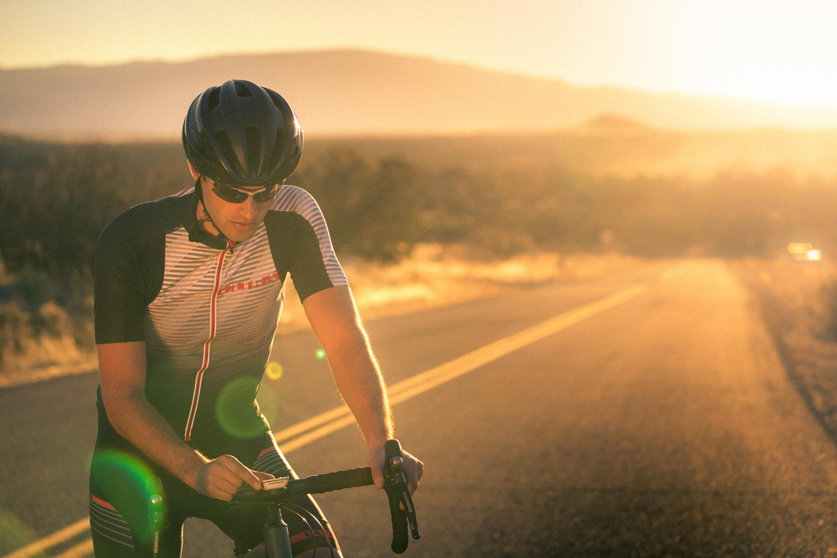 Road cyclist athlete in Sedona Arizona at sunset.
