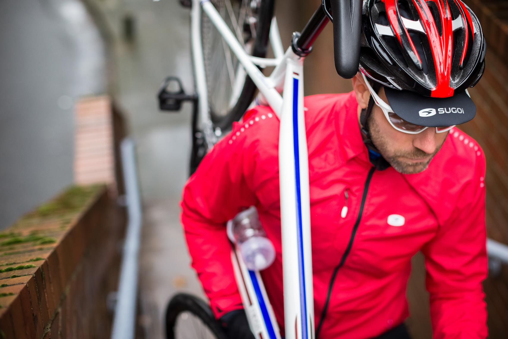 Sugoi bike jacket and helmet shown by commercial apparel and product photographer