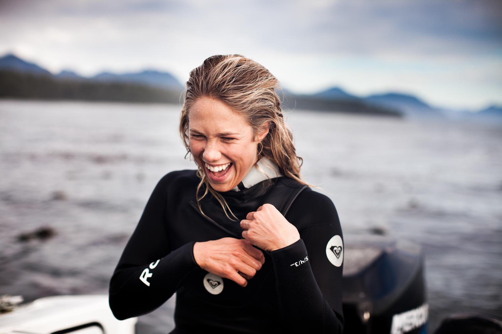 Portrait of pro female surfer in Tofino, British Columbia, Canada