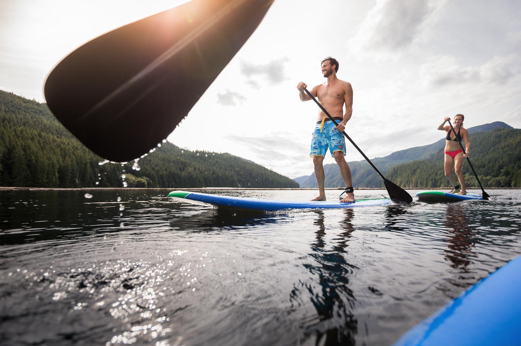 Standup paddleboarding in British Columbia Canada by tourism and lifestyle photographer