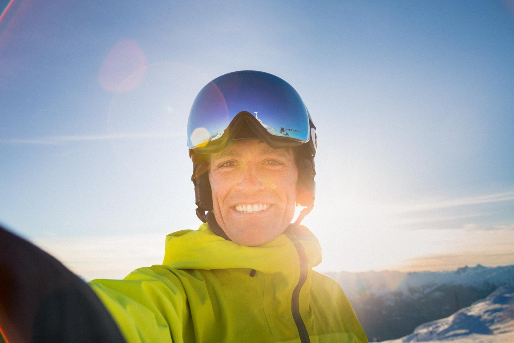 Smiling skier in Whistler BC by lifestyle and tourism photographer