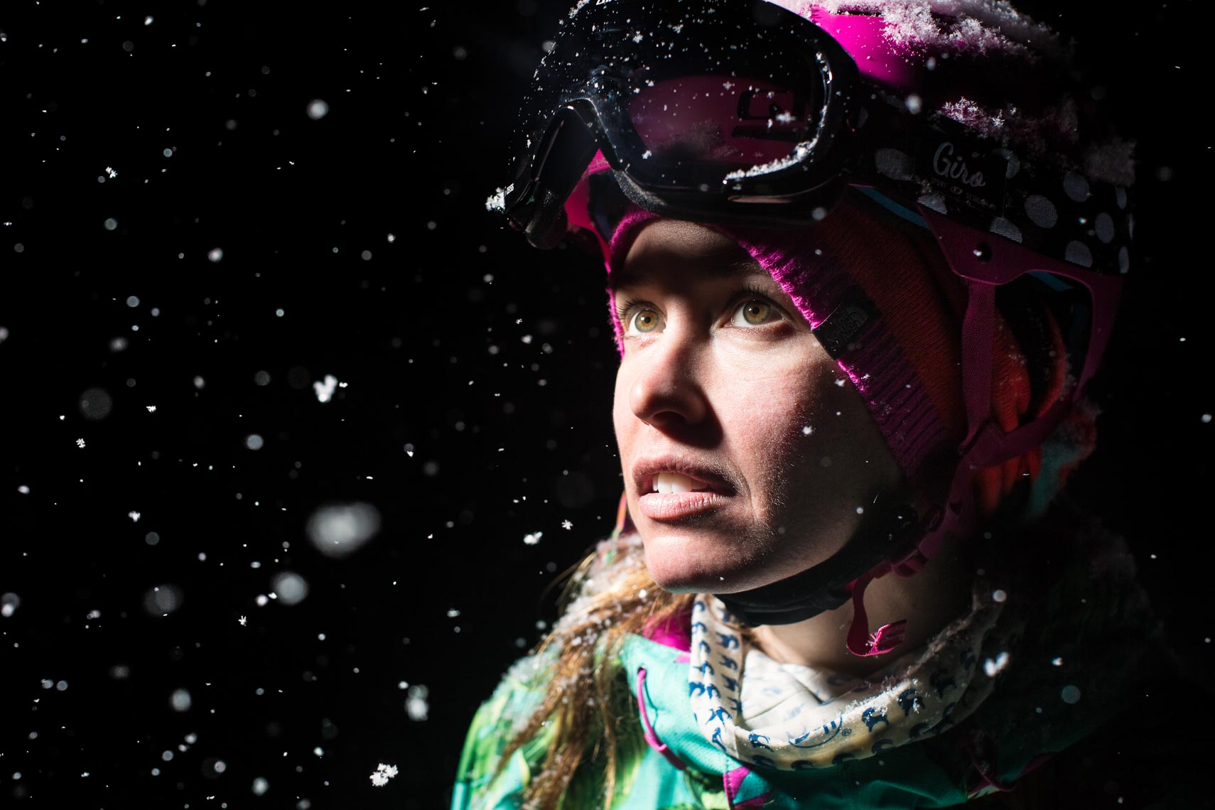Giro helmet portrait of female ski athlete in Japan with snowflakes