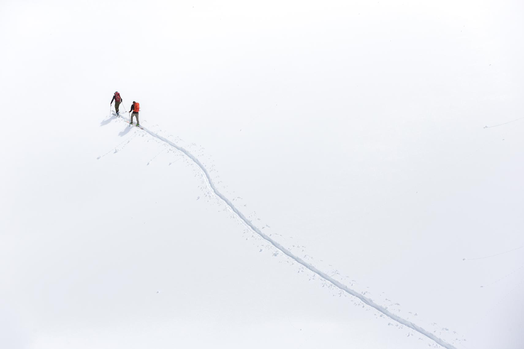 Minimalist ski touring image with white background photographed by Whistler ski photographer