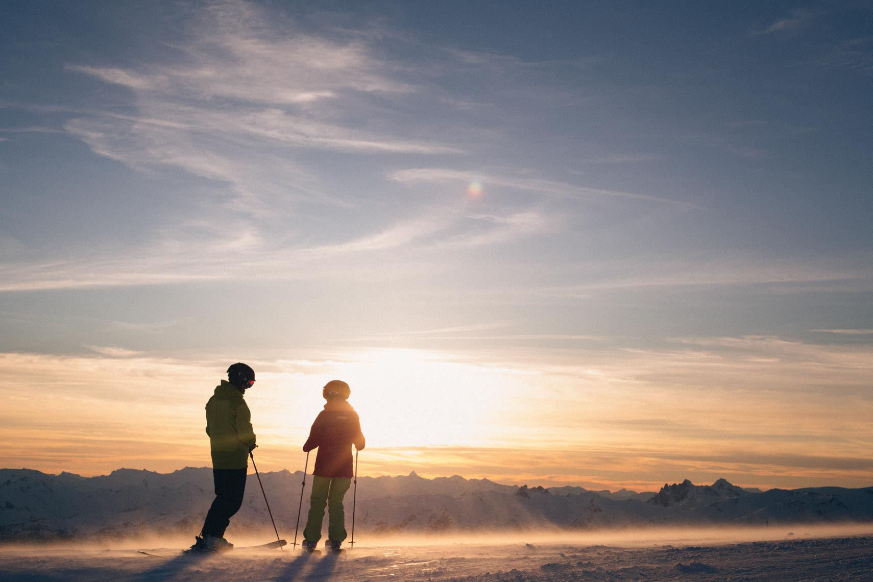 Silhouetted ski couple at sunset in Whistler BC