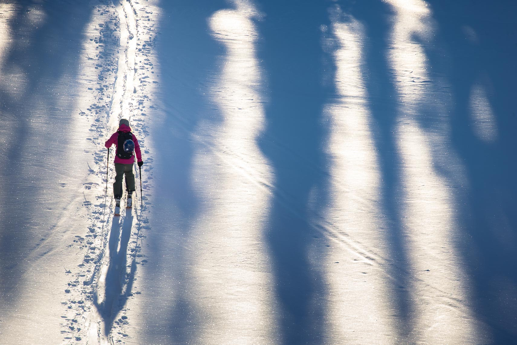 Ski touring athlete documented by Canadian ski photographer