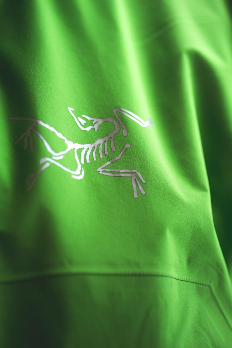 Arcteryx logo shown on green ski jacket worn by Eric Hjorleifson