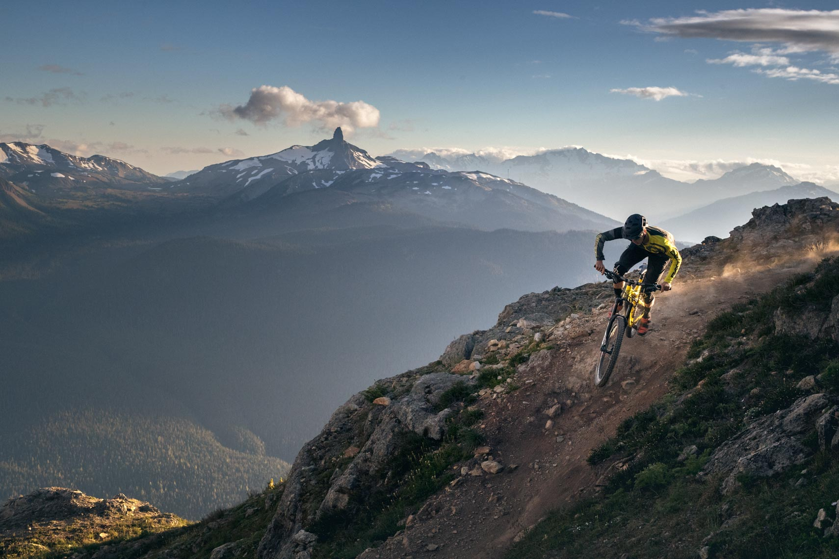 Mountain bike pro athlete in Whistler BC mountains with tusk visible.