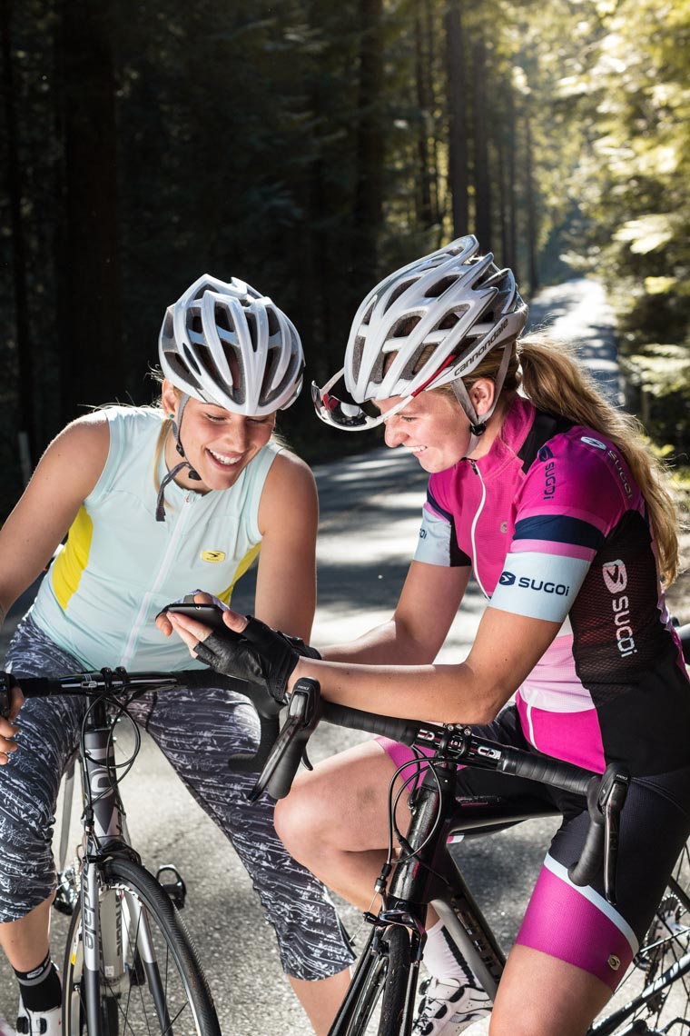 Female cyclists wearing Sugoi bike clothing in Vancouver BC by commercial photographer