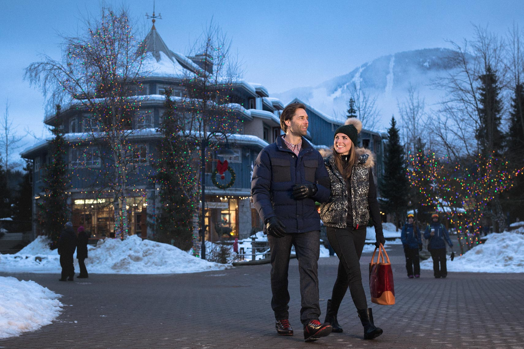 Couple walking in Whistler Village in the evening