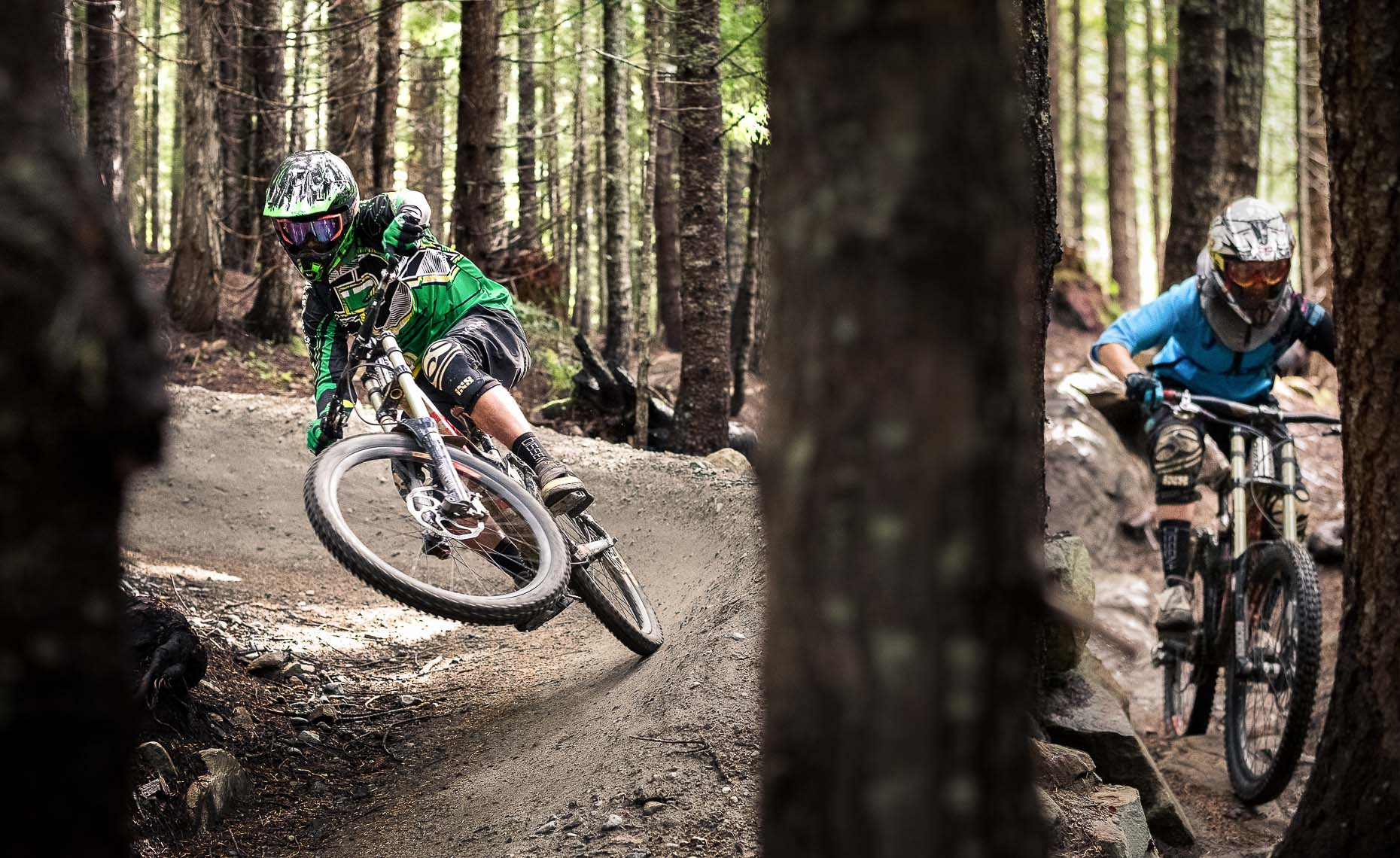 Double mountain bike action shot with two pro athletes.