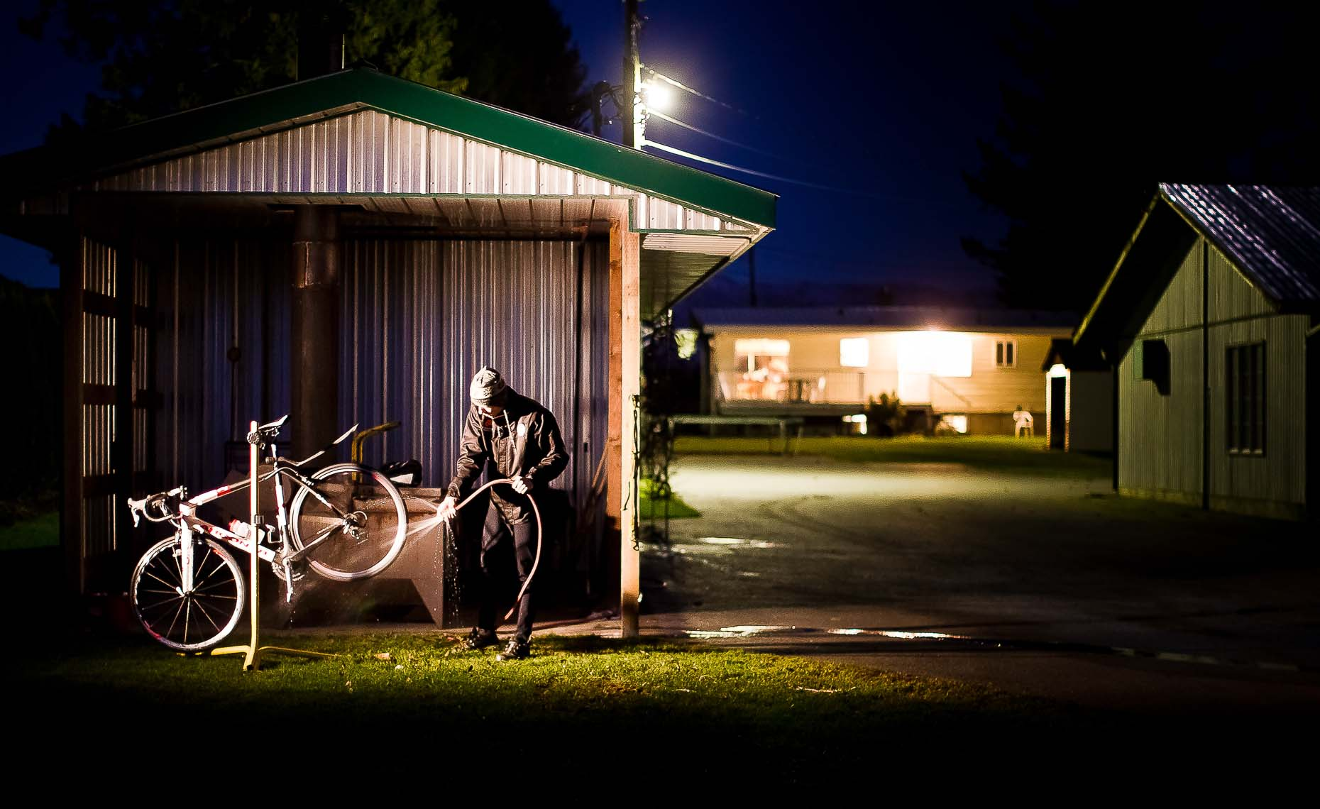 Will routley night photography shot of bike cleaning.