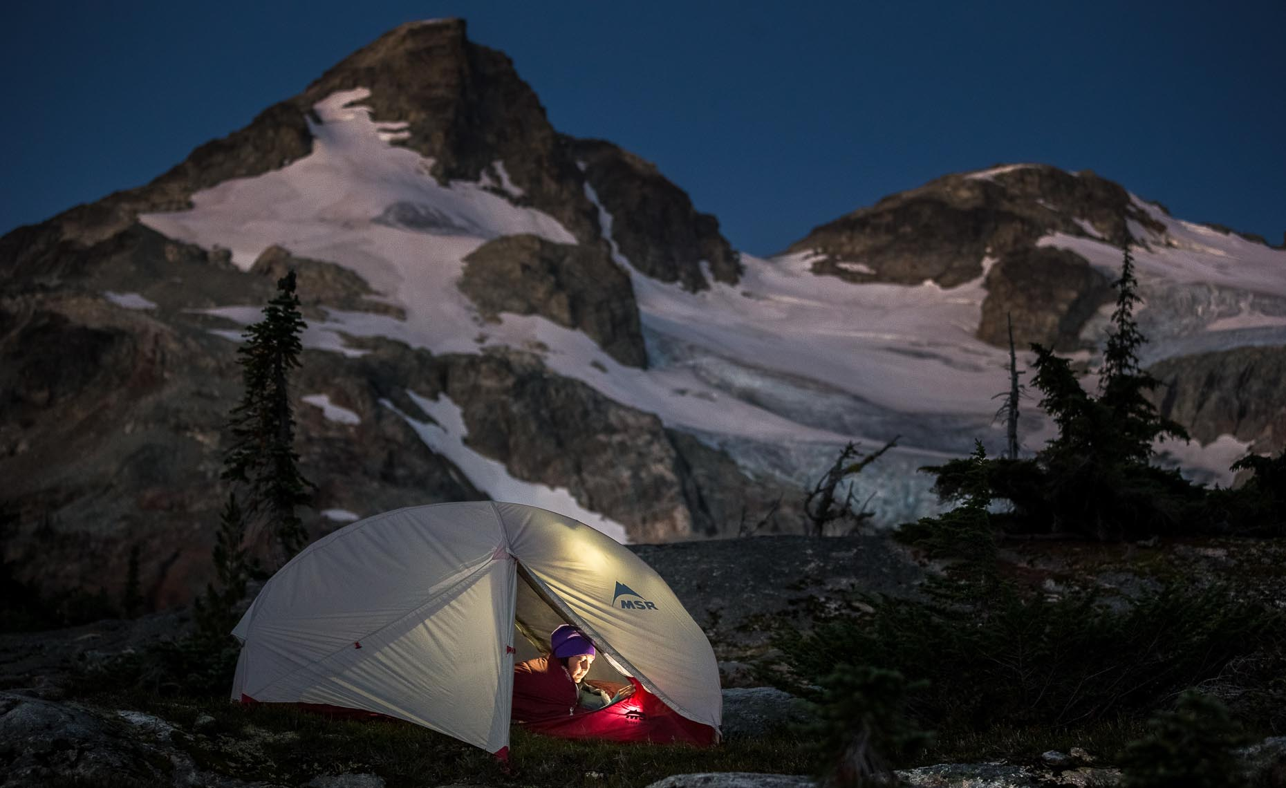 Night camping photographer in the whistler mountains