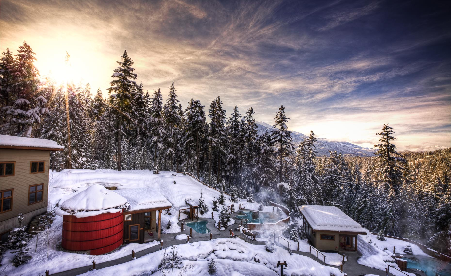 Scandinave spa in whistler BC at sunset in the winter.