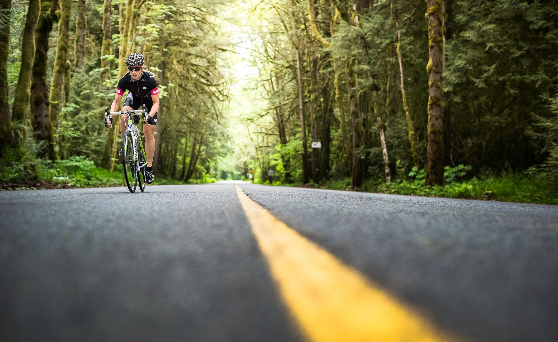 Forest road cycling photographer