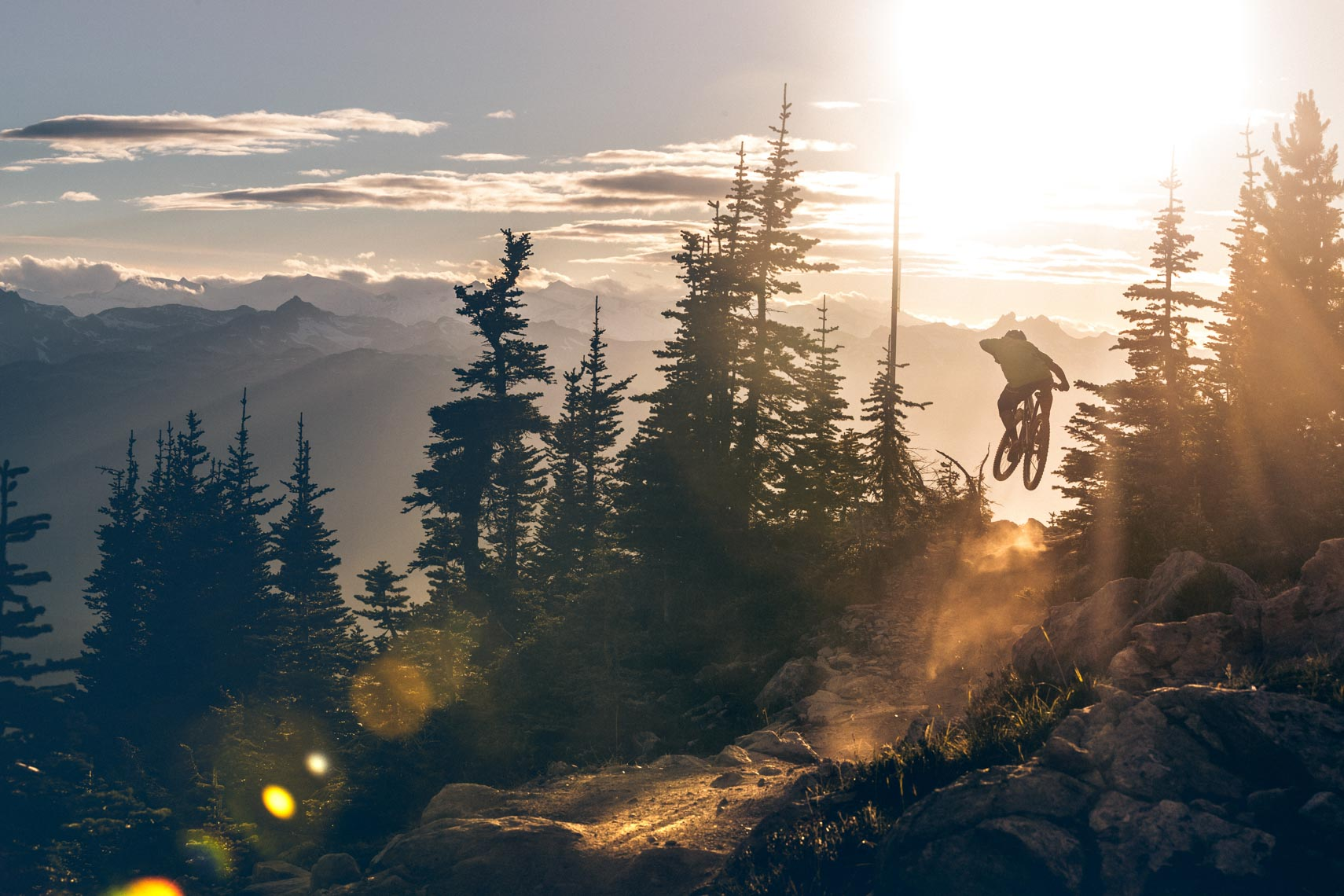 Silhouette mountain bike athlete at sunset in the mountains of Whistler, BC