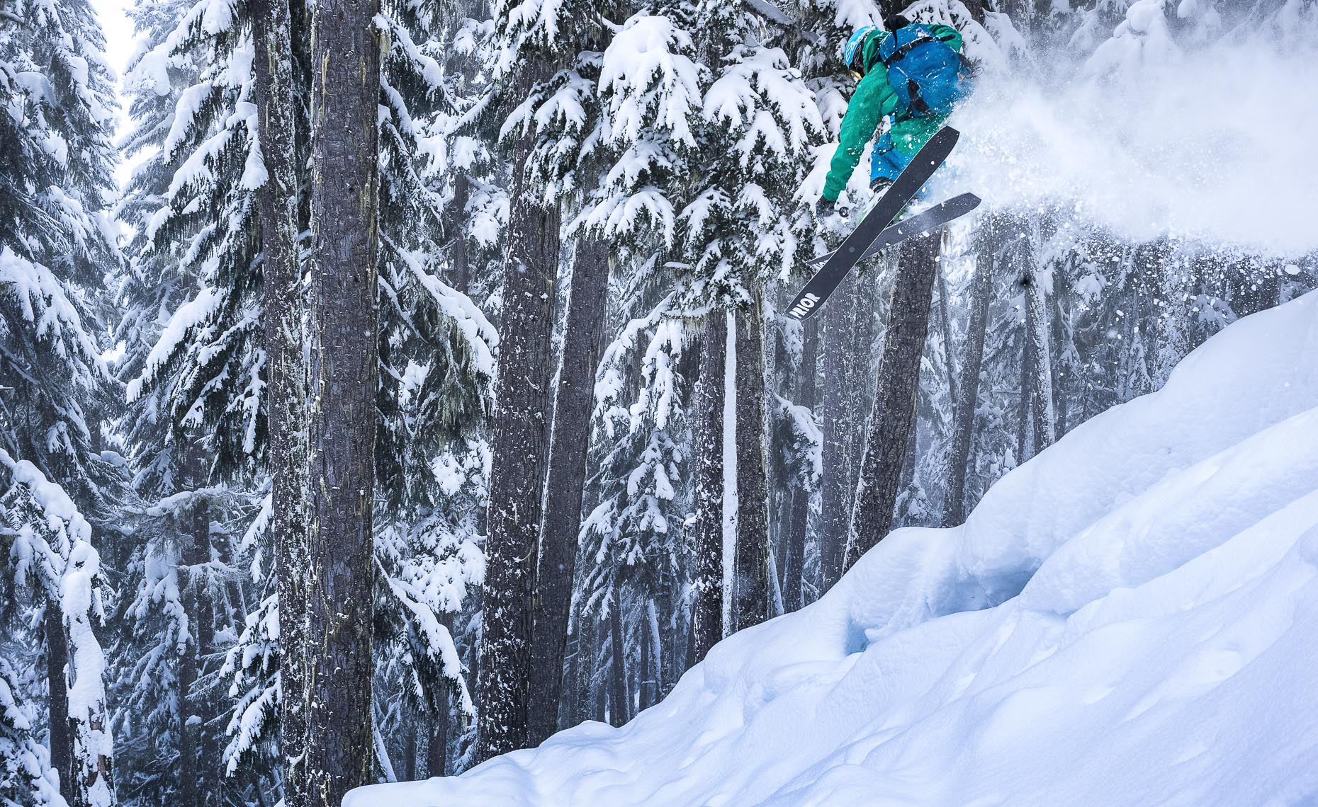 Ski jump action in the forest on whistler mountain