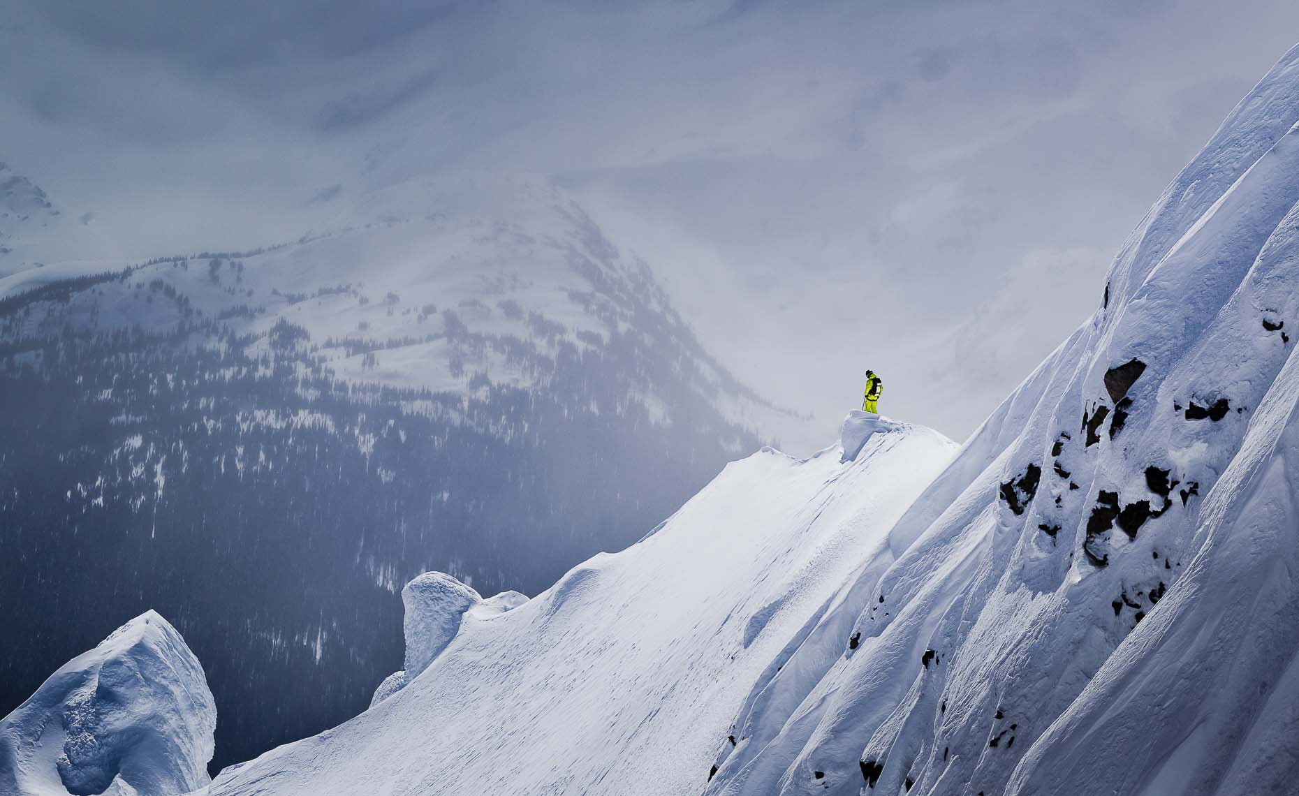 Heliskiing photographer in whistler documenting ski athletes.