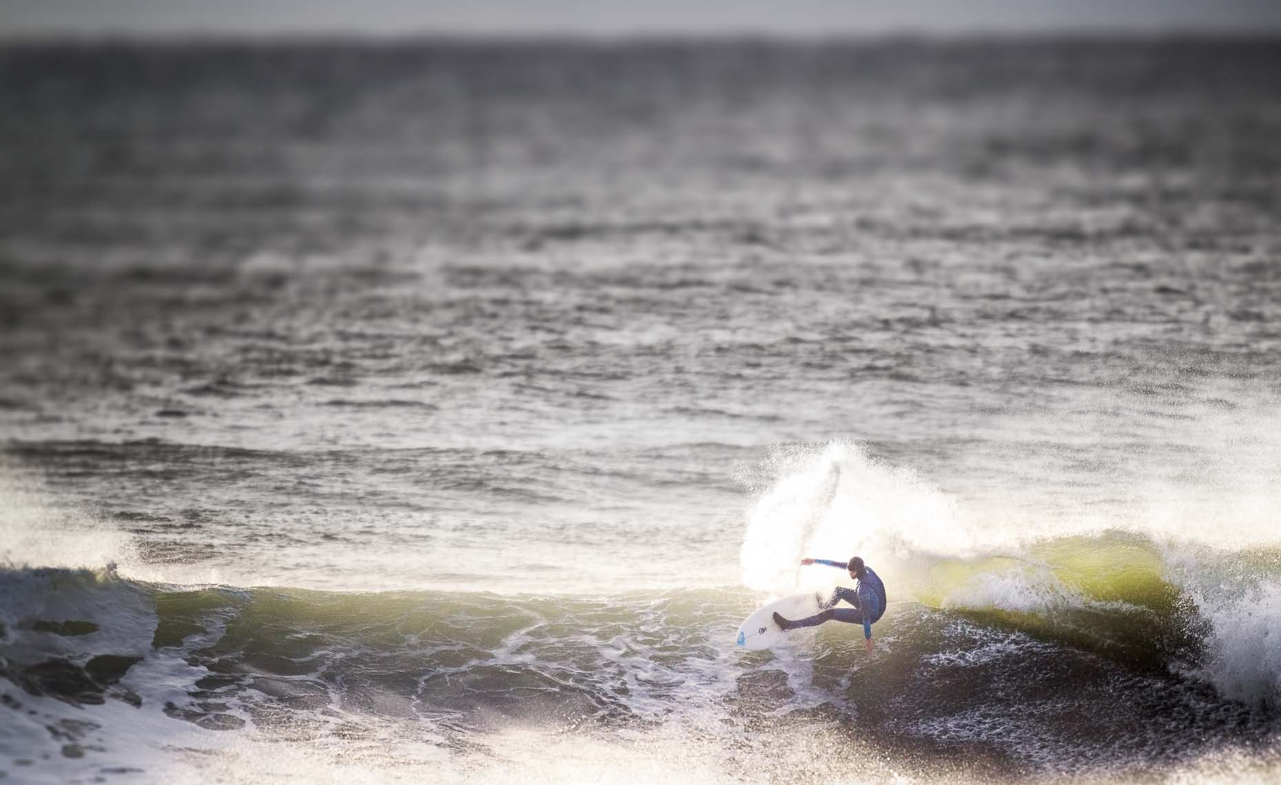 Female surf action documented by photographer in tofino BC.