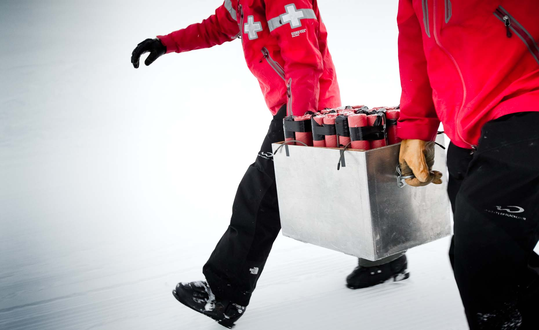 Whistler mountain ski patrol carrying dynamite during a documentary photography project.