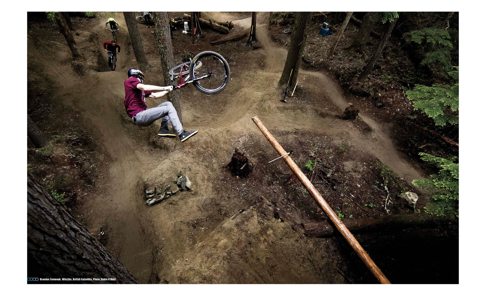 Brandon Semenuck bike jump in whistler forest overhead shot