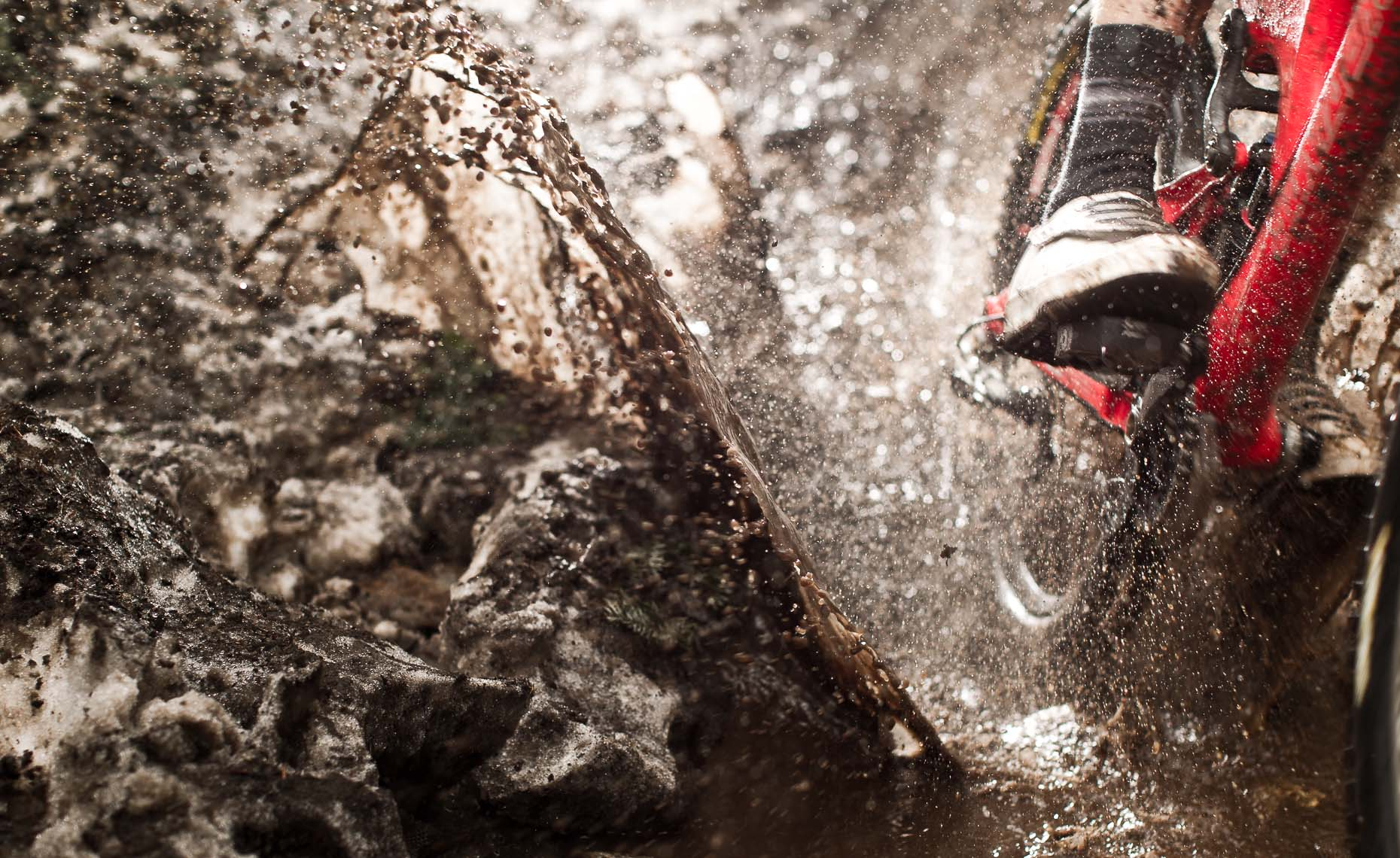 Closeup of snow and mud splash by mountain bike rider